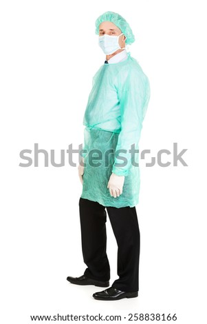 Mature male doctor wearing protective clothes. - stock photo