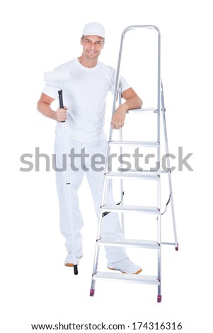 Mature Male Painter With Paint Roller And Ladder Over White Background - stock photo