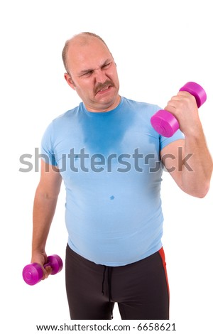 Mature male trying to lift one kilo weights with a lot of effort - stock photo