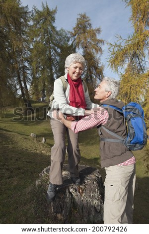 Mature man and woman hiking in the forest