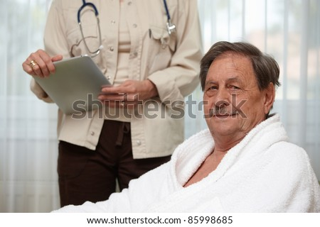 Mature man at health control, looking at camera.? - stock photo