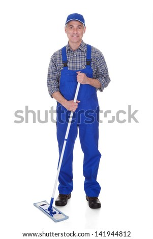 Mature Man Cleaning Floor With Mop Over White Background - stock photo