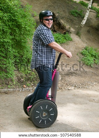 Mature man driving on segway