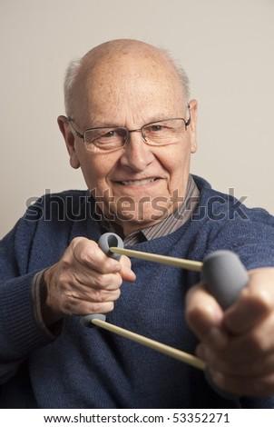 Mature man exercising at home - stock photo