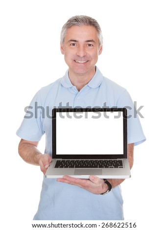 Mature Man Holding Laptop Over White Background - stock photo