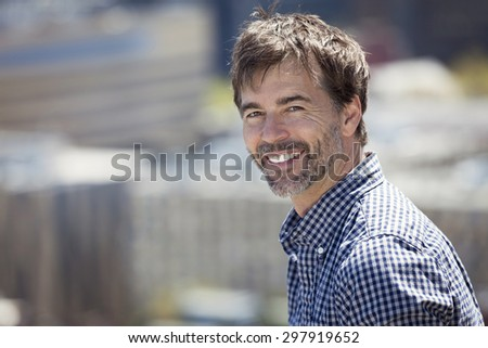 Mature Man Investor Smiling At The Camera - stock photo