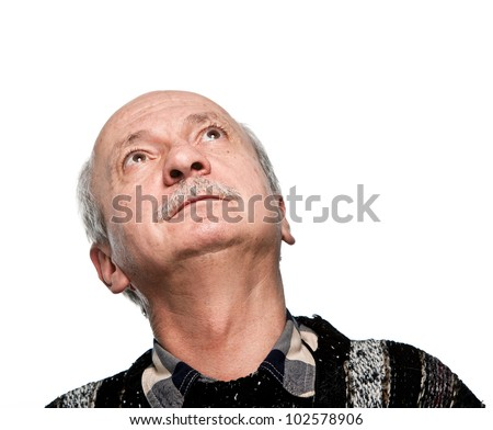 mature man looking up with hope isolated on white
