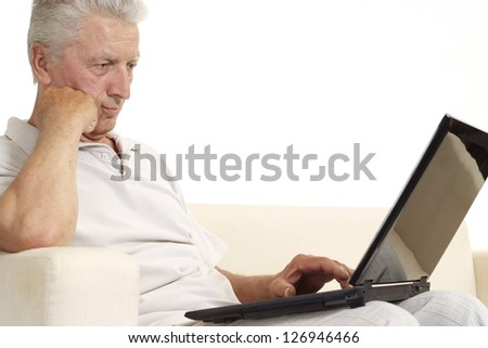 Mature man relaxing at home on a white background - stock photo