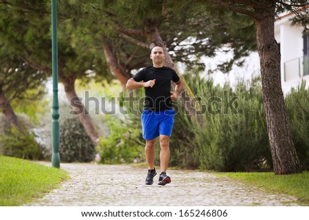 Mature man running at the city park