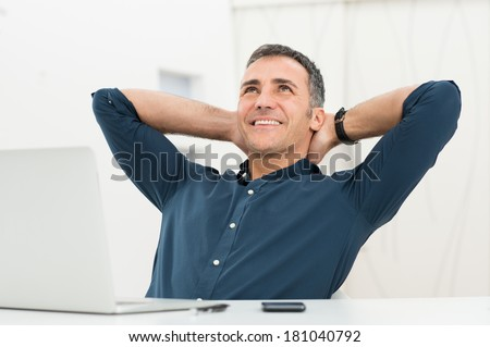 Mature Man Satisfied Sitting In Front Of Laptop Daydreaming - stock photo