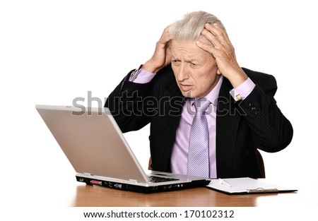 Mature man sitting at the computer on a white