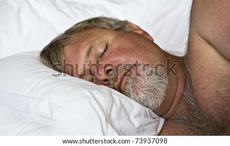 Mature man sleeping peacefully - stock photo