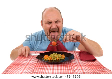 Mature man sticking out his tongue in disgust - stock photo