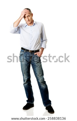 Mature man suffering from headache. - stock photo