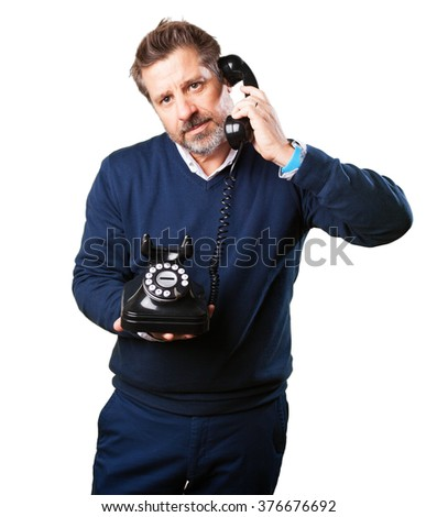 mature man talking on telephone - stock photo