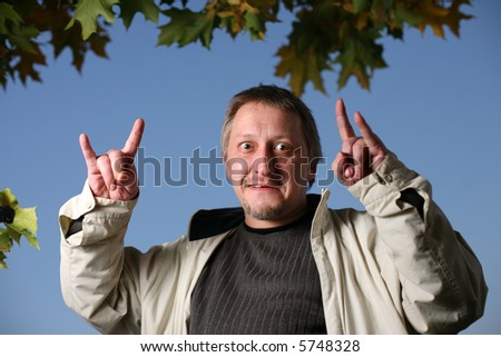 Mature man throwing the goat - stock photo