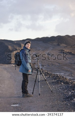 Mature Man using Camcorder - stock photo