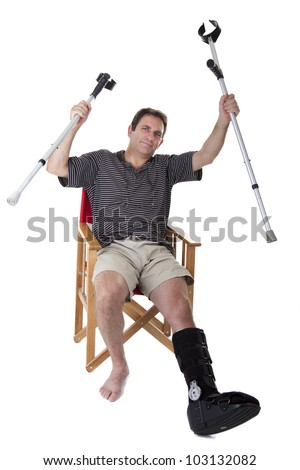Mature man with a broken leg, with crutches, and showing a boring expression