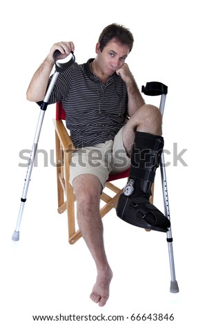 Mature man with broken legs, with crutches, and showing a boring expression.