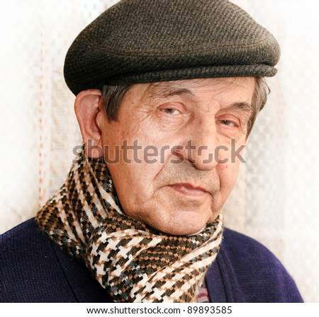 Mature man with hat and scarf outdoor