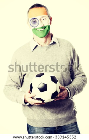 Mature man with India flag painted on face. - stock photo