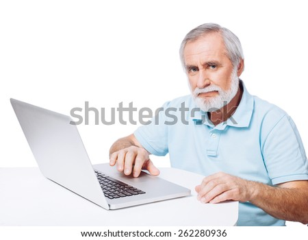 Mature man working on laptop, isolated on white - stock photo