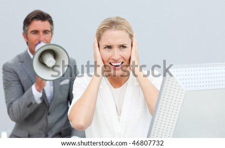 Mature manager yelling at his colleague in the office - stock photo