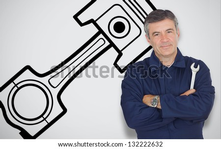 Mature mechanic standing next to car symbol while looking at camera - stock photo