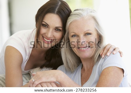 Mature Mother And Daughter Hugging - stock photo