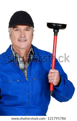 mature plumber holding plunger - stock photo