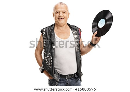 Mature punk rocker holding a vinyl record and looking at the camera isolated on white background - stock photo
