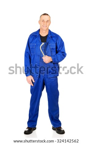 Mature repairman holding his wrench. - stock photo