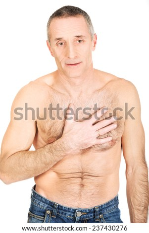 Mature shirtless man with chest pain. - stock photo