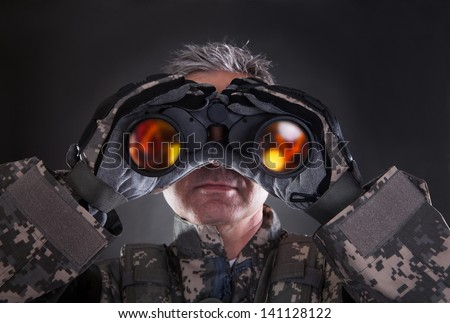 Mature Soldier Looking Through Binoculars Over Black Background - stock photo
