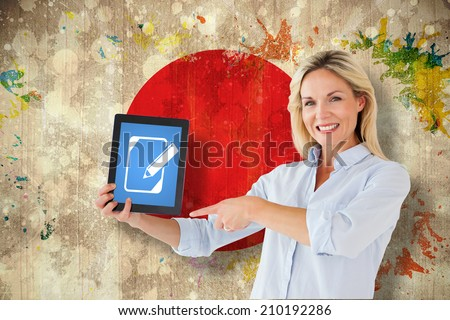 Mature student pointing to tablet against grunge japan flag