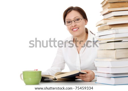 Mature student woman is learning at the desk - stock photo