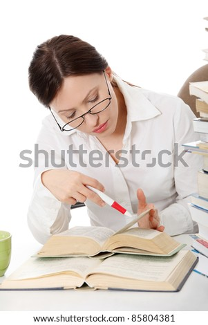 Mature student woman is learning at the desk , against white background