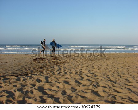 Mature Surfers on the beach