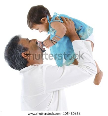 Mature traditional Indian father raise her baby girl up, isolated on with background - stock photo