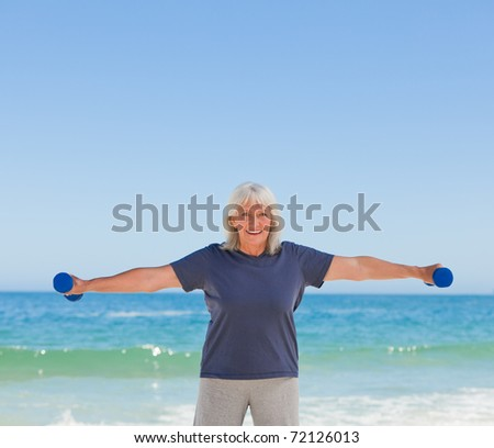 Mature woman doing her exercises - stock photo