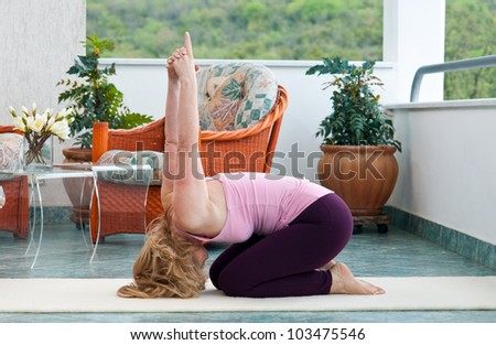 mature woman exercise on her balcony