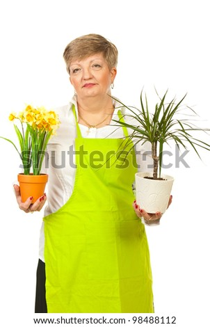 Mature woman florist holding pots with flowers isolated on white background