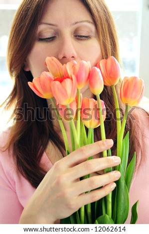 Mature woman holding bouquet of flowers - stock photo