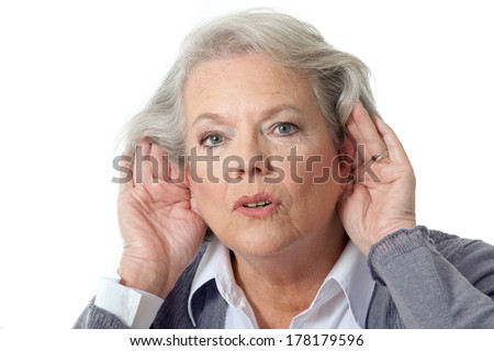 Mature woman holding hands to ear