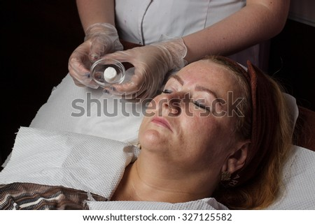 Mature woman in salon spa