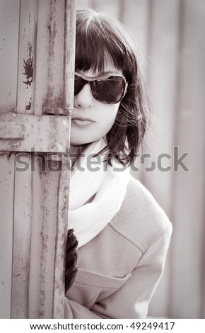 Mature woman in sunglasses watching someone. Retro style.