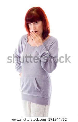 Mature woman looking shocked