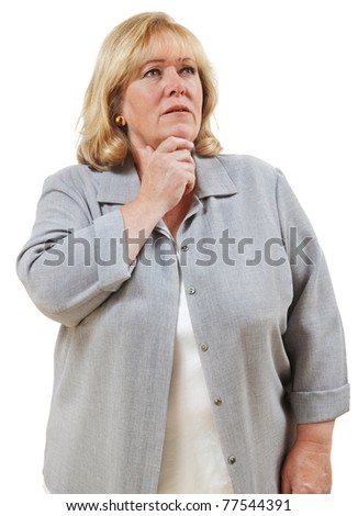 Mature woman looks puzzled, chin in hand - stock photo