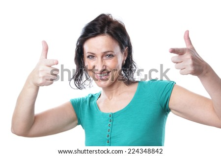 mature woman making pistol hand sign - stock photo