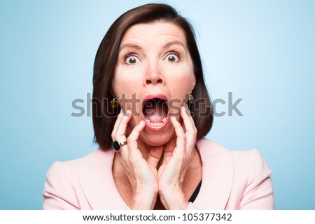 mature woman pulling funny faces - stock photo